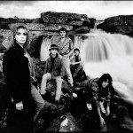 The shot of the band from past times, by a waterfall photo by Walter Mayr