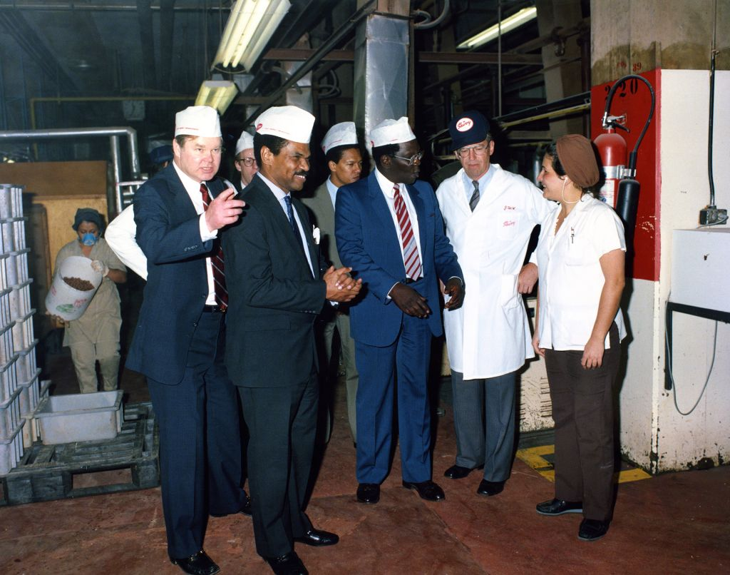 Reginald F. Lewis tours a factory owned by TLC Beatrice International