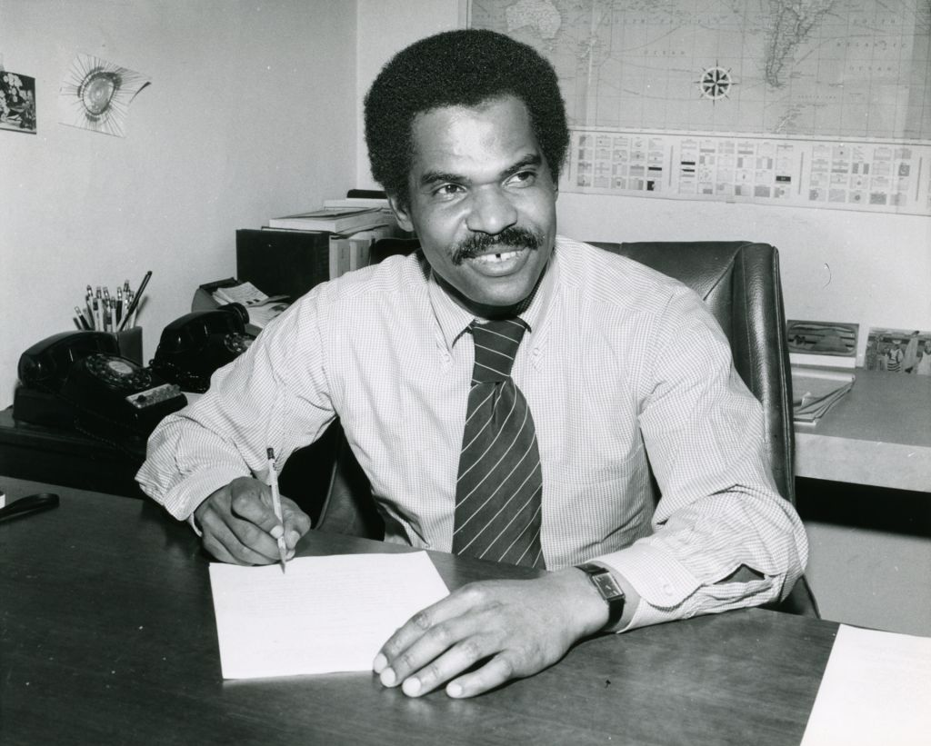 Reginald F. Lewis at work in his law office